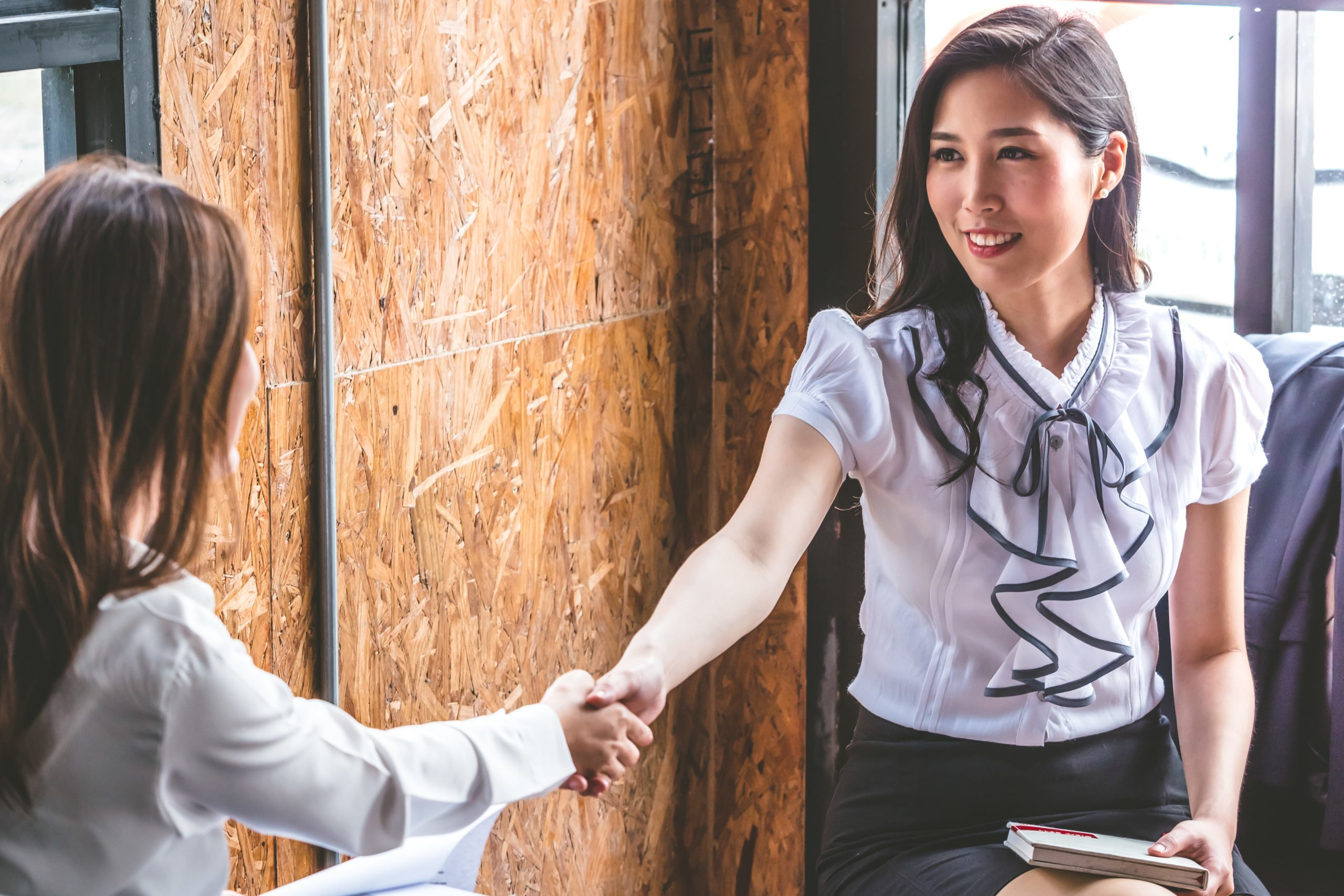 Successful business people shaking hands, finishing up a meeting.
